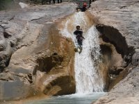 Falling down the rock slide on the canyoning route