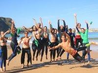Clase de surf para grupos en Playa de los Locos