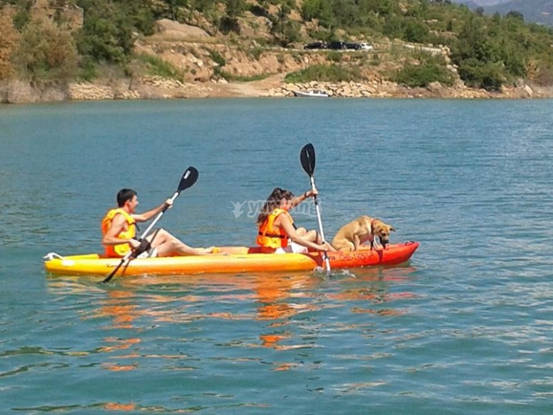 A couple sitting in a kayak