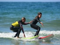Student and teacher surfing