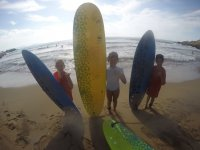 Young surfing students