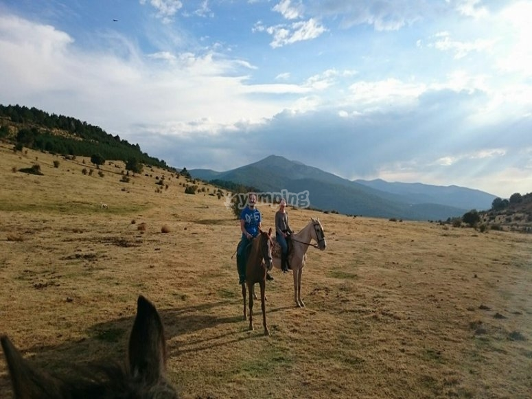 At horseback in the countryside