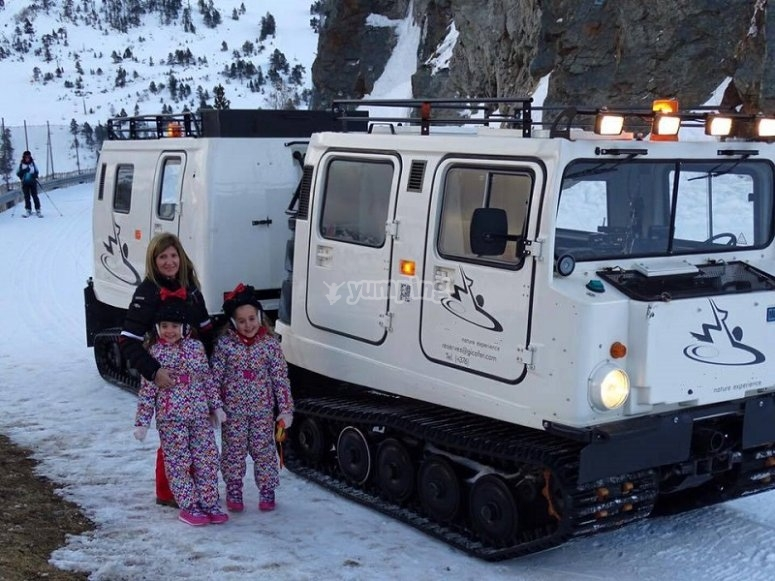 Family next to the articulated tracked vehicle