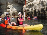 Kayaking with a hat to protect themselves