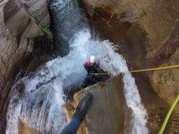 Rappelling in the waterfall of the river