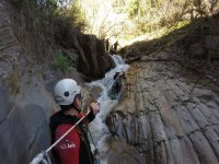 Holding the rope to lower the ravine