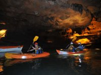 Kayaking expedition through the cave