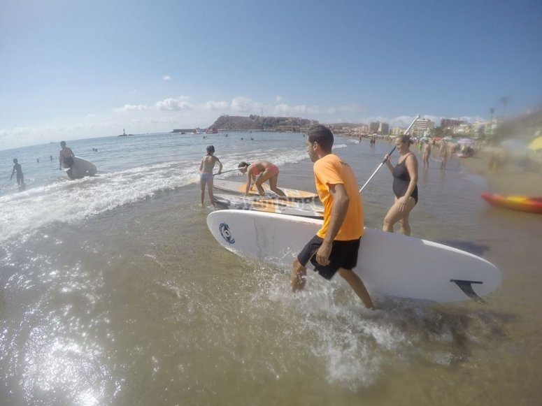 Running to the water with the boards
