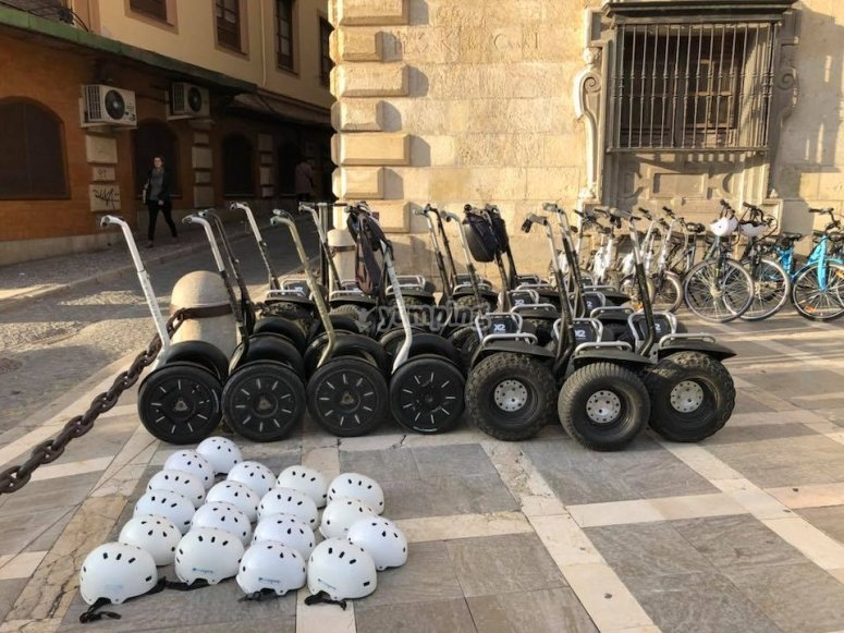 Group of segways parked on the street