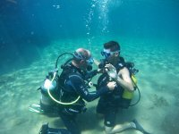 Helping the student underwater