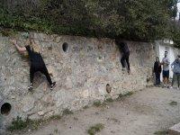 Climbing the boulder wall