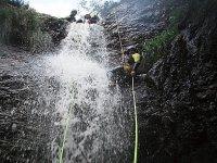 Waterfall, rope and adventurer