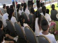 children sitting on their backs