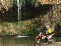 Motorcycle next to the waterfall