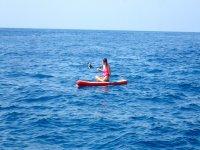 Sitting on the board enjoying the sea