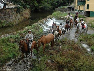 Horse riding in Ponte Caldelas River Beach.