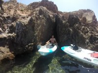 Kayaks between the coves