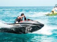 Jet ski skirting the boat