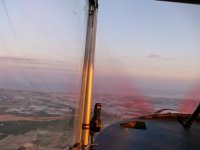 Helicopter flight at sunset