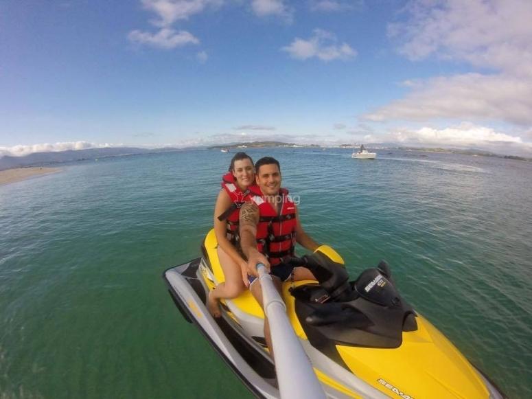 Couple riding a jet ski
