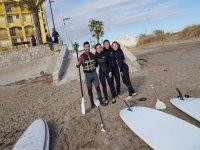 Con el equipo de paddle surf