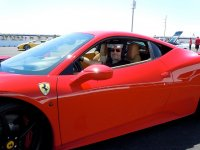 enjoying the driving of a Ferrari