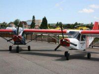 Fleet of light aircraft about to take off from La Morgal