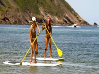 Trying paddle surf