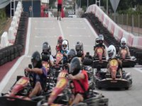 boys driving go-karts on a track