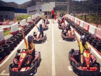 chocs performing a go-kart race reaching the finish line