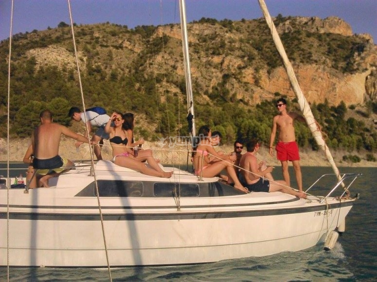 Friends group by sailing boat