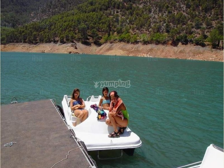 young people in pedal boats