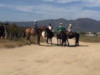 Imparare l'equitazione nel sito naturale di Rubina