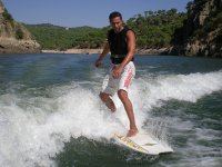 Surfing the wake of the boat