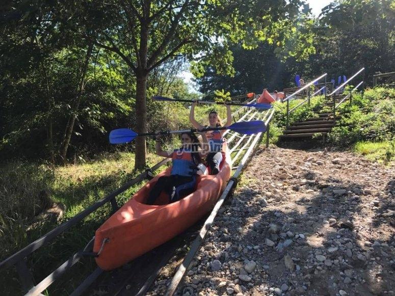 A canoe sliding through the slide