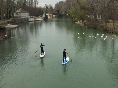 Paddle surfing in front of Palace of Aranjuez
