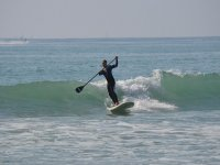 Olas y paddle surf
