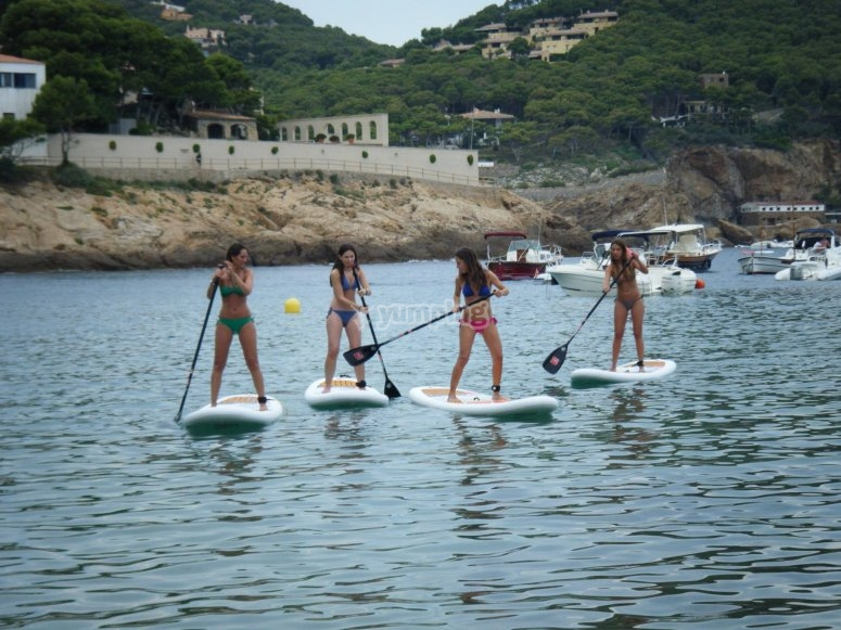 Group of women doing SUP