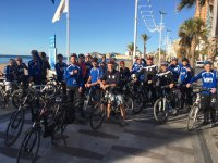 Group departure through Benidorm by bike