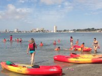 In the beach with canoes