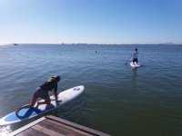 Getting on the SUP surfboard