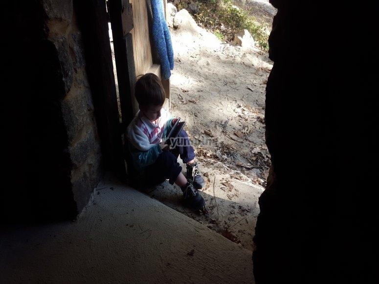 Sat in the doorway of the hut