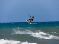 Leaving the sea with the kite board