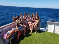Girlfriends toasting on the boat