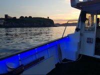 Illuminated boat at dusk