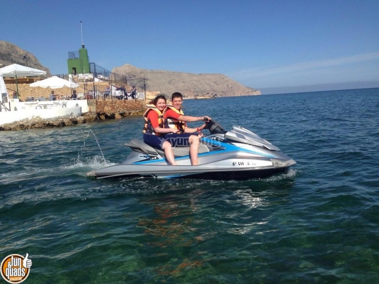 Couple riding jet skis