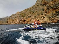 Two people on a jet ski in Altea