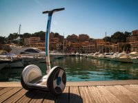 Empty Segway next to the boats