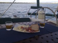 A snack of ham and cheese in the boat