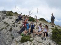 Sitting on the mountain with hiking poles